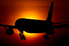 Airbus A330 passenger airplane crossing the sun.  Royalty Free Stock Photos