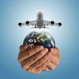 Airbus plane and globe. Hand holds airbus plane and globe as concept, elements of this image furnished by NASA Royalty Free Stock Photo
