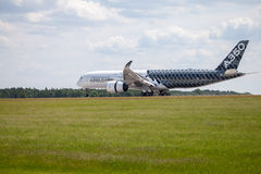 Airbus A 350 - 900 plane lands on airport in Berlin Stock Photos