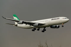 Airbus A340 Plane. Mahan Air Airbus A340 Plane in the sky Stock Photos