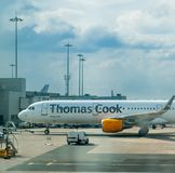 MANCHESTER, UK - 9TH APRIL 2019: A Thomas Cook aircraft sits waiting for passengers at Manchester Airport royalty free stock photography