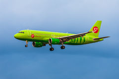 Airbus a320 S7 Airlines on the background of storm clouds Stock Photography