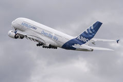 Airbus A380 Taking Off. Beautiful Airbus A380 double decker airliner taking off into cloudy sky stock images