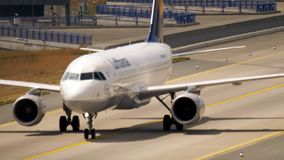Airbus A320 taxiing after landing. FRANKFURT AM MAIN, GERMANY - JULY 18, 2017: Airbus A320 Lufthansa, taxiing after landing at 07L. Fraport, Frankfurt Germany stock video footage