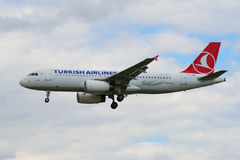 Airbus A320-232 (TC-JPM)— Turkish Airlines closeup on the background of cloudy sky Royalty Free Stock Images