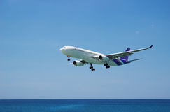 Airbus A330-300 of Thai Airway. Landing, flies from the ocean Stock Images