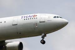 Airbus A300-600 of Thaiairway. Chiangmai, Thailand - Auguest  22 2012: HS-TAZ Airbus A300-600 of Thaiairway. Landing to Chiangmai airport from Bangkok royalty free stock photos