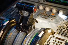 Airbus A320 thrust levers. On the centre pedestal instrument panel. Switches and dials visible in the background royalty free stock photos