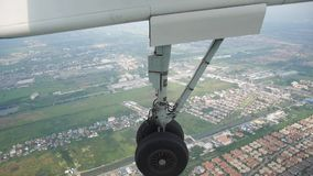 Airbus twin propeller flying from Phrae prepare wheel for landing to runway stock video