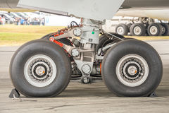 Airbus A350 undercarriage. Farnborough, UK - July 15, 2016: Closeup section of an Airbus A350 undercarriage on the taxiway at an aviation trade event in Royalty Free Stock Images