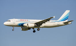Airbus A320-214 (VP-BHZ) company Yamal Airlines before landing in Pulkovo airport Royalty Free Stock Image