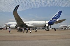 Airbus A350. XWB (Extra wide body) at the Singapore Airshow 2014 at Changi Exhibition Centre, with the Boeing 787 it competes with in the background Royalty Free Stock Photo