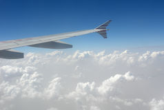 Aircarft in clouds. Aircraft wings with beautiful clouds scene stock images
