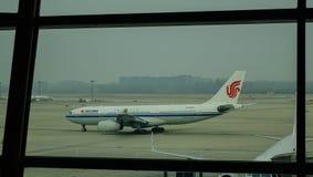Aircarft sur l'aéroport capital de Pékin, Chine Image libre de droits