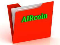 AIRcoin- bright green letters on a gold folder Royalty Free Stock Photos