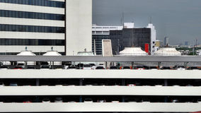 Aircondition condensing  in top of parking building. Buiding in the busy city Stock Photos