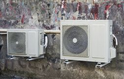 Airconditioner on the  wall of the house. Airconditioner on the wall of the house.nnn Royalty Free Stock Photo