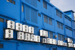 Airconditioners on Blue Building. Image of aircondition compressors on a blue building Stock Images