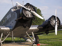 Aircraft. The image shows old silver propeller aircraft standing on the ground. It is a Junkers plane, as far as I know a Ju-52. The pictures shows not the royalty free stock photos