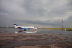 Aircraft. Private aircraft on airport runway Stormy clouds royalty free stock photos