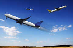 Aircraft. In flight over the blue clouds Stock Photo