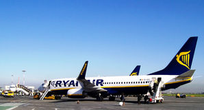 Aircraft. Ryanair aircraft embarking passengers in Ciampino airport, Italy. Photograph taken on October, 2010 stock photography