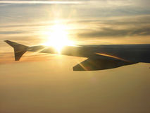 Aircraft. Boeing 737-400 - aircraft with sunset and rays Royalty Free Stock Photos