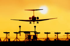 Aircraft. In sunset, landing royalty free stock photos