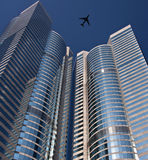 Aircraft above skyscrapers - Hong Kong Royalty Free Stock Photo