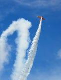Aircraft Acrobatics. Aircraft performing acrobatics at air show royalty free stock photography