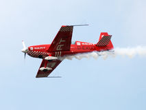 Aircraft in aerobatic flight in the blue skies royalty free stock photography