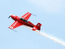 Aircraft in aerobatic flight in the blue skies. Aerial tricks with own plane for aerobatics royalty free stock photo