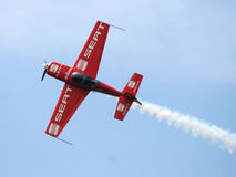 Aircraft in aerobatic flight in the blue skies royalty free stock images