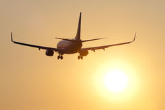 Aircraft against sunset Stock Photography