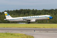 Aircraft Airbus A321 special retro livery of Lufthansa is landing on the runway at airport Pulkovo Stock Images