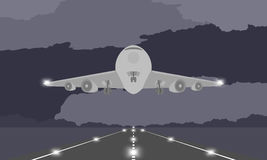 Aircraft or airplane landing or takeoff on runway at nighttime illustration on dark sky. And cloud background, with copy space Stock Photo