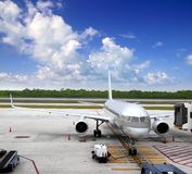 Aircraft airplane plane landed airport blue sky. Clouds Stock Images