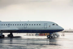 The aircraft on the airport apron. Under heavy rain royalty free stock images