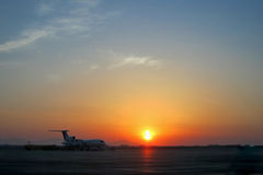 Aircraft at the airport with sunset Stock Images