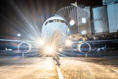Aircraft apron at the parking gangway at the airport at night with the lights turned off landing. Stock Photo