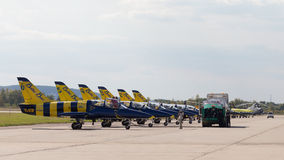 Aircraft Baltic Bees from Latvia. The Moscow region - August 28 2015: Aerobatic team Baltic Bees from Latvia on the L-39 planes refuel its aircraft fuel at an Royalty Free Stock Image