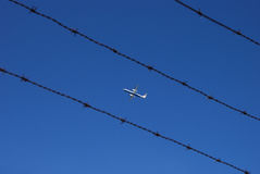 Aircraft and barbed wire Stock Images