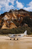 Aircraft on the beach of Fraser Island. A picture of an aircraft on the beach of Fraser Island (Queensland Australia), with the Coloured Sands sandstone Stock Photography