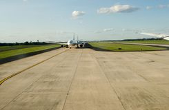 Aircraft at runway for takeoff. Aircraft at beginning of runway getting ready for takeoff Royalty Free Stock Images
