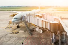 Aircraft being being maintenance at gate terminal, Business tran Royalty Free Stock Photo
