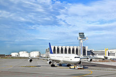 Aircraft being pushed back by a pushback vehicle Stock Photo