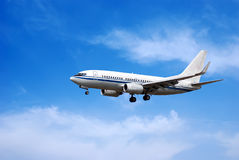Aircraft in blue sky Stock Images