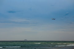 aircraft in blue sky above azure sea Royalty Free Stock Photography