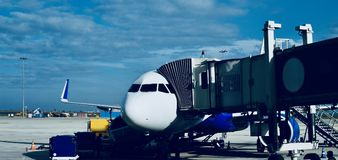 An aircraft is boarding its passengers in an airport unique photo. An aircraft is boarding its passengers before the departure in an airport unique royalty free stock photography