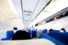 Aircraft cabin. Interior of aircraft cabin with passenger Royalty Free Stock Photo